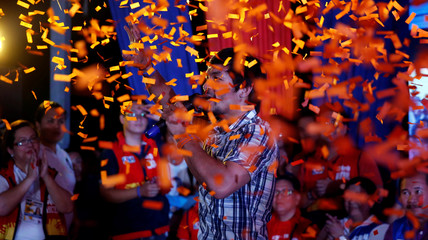 Confetti rains on Filipino boxer Manny Pacquiao and Senatorial candidate for May 2016 national elections as he speaks to his supporters during election campaigning  in San Pablo, Laguna