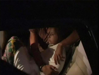 Still image taken from video of one of the two British teenage victims of an acid attack being comforted by an unidentified man in a vehicle at the airport in Zanzibar