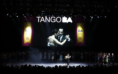Maximiliano Cristiani and Jesica Arfenoni from Argentina dance after winning the Tango World Championship in Salon style in Buenos Aires