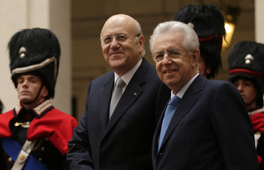 Italy's Prime Minister Monti and Lebanon's Prime minister Mikati arrive to attend a meeting at Chigi Palace in Rome