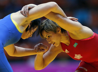 China's Zhou Feng fights Kazakhstan's Guzel Manyurova during her women's 75kg freestyle gold medal wrestling match at Dowon Gymnasium during the 2014 Asian Games in Incheon