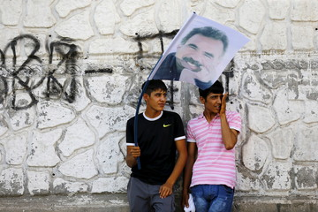 Demonstrators hold a portrait of Kurdistan Workers Party jailed leader Abdullah Ocalan during a march in solidarity with him in Diyarbakir