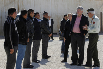Canada's PM Harper and wife Laureen listen to Major General al-Khalidi, of Jordanian army, during tour at center of World Food Program during their visit to Al Zaatrai refugee camp, in Mafraq