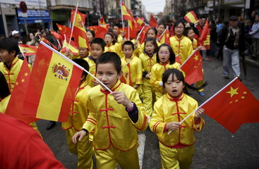 Children perform during a parade to celebrate the Chinese Lunar New Year, which welcomes the Year of the Monkey, in Madrid, Spain