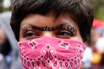 """A woman stands with """"No Ometeotl DAPL"""" drawn on her face during a climate change rally in solidarity with protests of the pipeline in North Dakota at MacArthur Park in Los Angeles, California"""