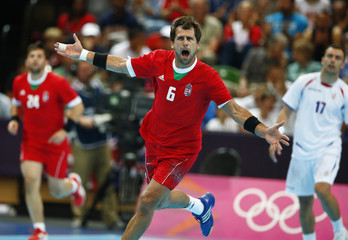 Hungary's Tamas Mocsai celebrates a goal against Serbia in their men's handball Preliminaries Group B match at the Copper Box venue during the London 2012 Olympic Games