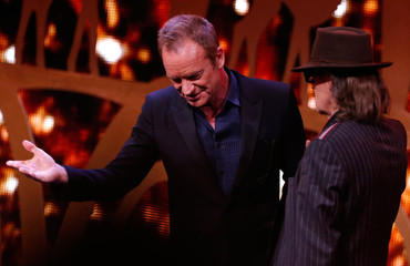 Sting congratulates singer Lindenberg after receiving the Music National award during the Bambi 2016 media awards ceremony in Berlin