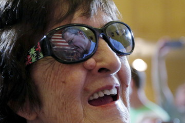 Republican presidential candidate Jeb Bush is reflected in the sunglasses of audience member Mary Currier during a town hall meeting campaign stop at the Medallion Opera House in Gorham