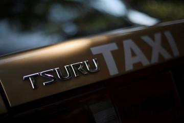A Nissan Tsuru logo is seen on a taxi, in Mexico City