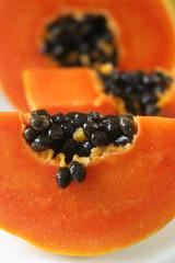Close up of papaya fruit cut open