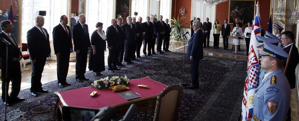 Czech President Milos Zeman addresses the newly named cabinet members during the inauguration ceremony at Prague Castle