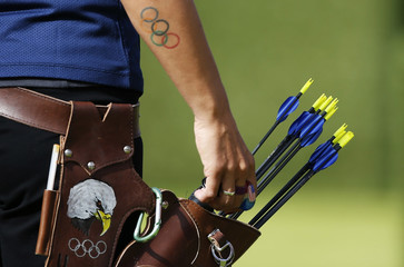 Khatuna Lorig of the U.S. reaches for an arrow from her quiver sporting a picture of an American bald eagle in the women's archery team quarterfinals at the Lords Cricket Ground during the London 2012 Olympic Games