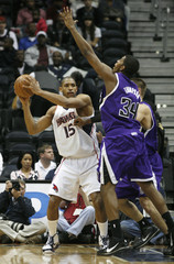 Hawks Horford looks to pass around Kings Thompson at their NBA basketball game in Atlanta