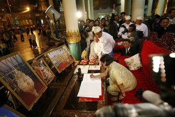 Thai Princess Maha Chakri Sirindhorn signs a guest book in Yangon