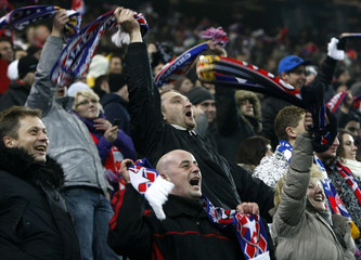 Wisla Krakow soccer fans react after their team advanced to the next round of UEFA Europa League after defeating the FC Twente team during their Europa League Group K soccer match in Krakow