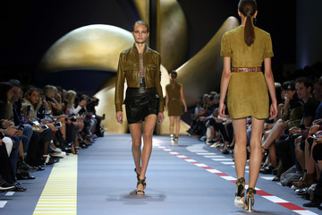 Models present creations by designer David Koma as part of his Spring/Summer 2016 women's ready-to-wear collection for Mugler fashion house in Paris