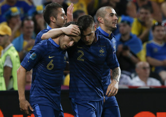 France's Cabaye is congratulated by team mate Debuchy after scoring against Ukraine during their Group D Euro 2012 soccer match at the Donbass Arena in Donetsk