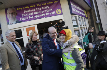 UKIP leader and Stoke Central by-election candidate Paul Nuttall embraces a supporter after a news conference in Stoke on Trent