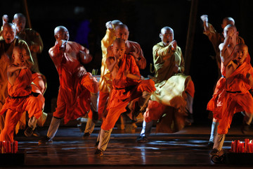 "A Shaolin monk performs at a show titled ""The Wheel of Life "" in Amman"