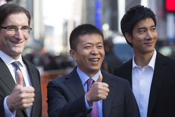 CEO of the Nasdaq-OMX Stock Market Robert Greifeld, Weibo Corporation Chairman Charles Chao and singer Wang Leehom pose near the NASDAQ MarketSite in Times Square for Weibo's initial public offering (IPO) on The NASDAQ Stock Market in New York