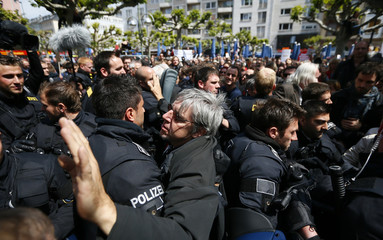 German riot police block demonstrators during a protest in Frankfurt