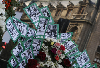 Pictures of victims of human rights abuses are seen during a rally in front of La Moneda Presidential Palace in Santiago
