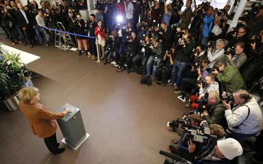 German Chancellor Merkel casts her vote in German general election at polling station in Bonn