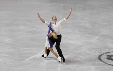 Bazarova and Larionov of Russia perform during their pairs free skating programme at the European Figure Skating Championships in Sheffield