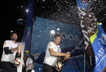 French skippers Dick and Beyou spray after winning the Jacques Vabre Transat race from Le Havre, France to Puerto Limon