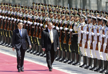 Pakistan's Prime Minister Sharif inspects the guard of honour with Chinese Premier Li during a welcome ceremony outside the Great Hall of the People in Beijing