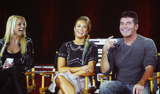 """Judges from the reality series """"The X Factor"""" are pictured on a video screen via satellite from Miami, at the Fox television network portion of the Television Critics Association Summer press tour in Beverly Hills"""