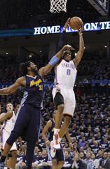 Denver Nuggets' Nene of Brazil fouls Oklahoma City Thunder's Russell Westbrook on a layup in Oklahoma City