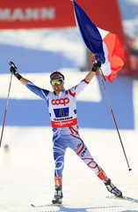 Jason Lamy Chappuis of France celebrates France's gold medal in the Nordic Combined Team Sprint 2x7.5km competition at the Nordic Ski World Championships in Tesero