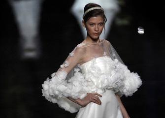 Model presents a creation by Lebanese fashion designer Elie Saab for the company Pronovias during the Gaudi bridal fashion show in Barcelona
