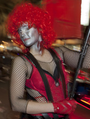 Member of tperformance troupe leads a procession during  Mardi Gras parade in New Orleans.