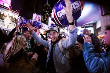 New York Giants fans celebrate the Giants' victory over New England Patriots at the end of their NFL Super Bowl game, in Manhattan