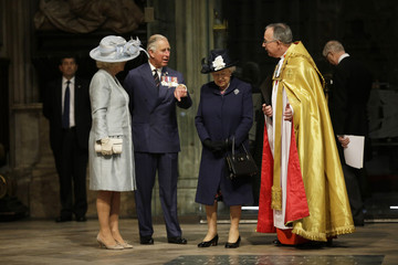 Britain's Queen Elizabeth speaks with Prince Charles, Camilla, Duchess of Cornwall and John Hall, at Westminster Abbey on the final day of 70th VE day commemorations in London
