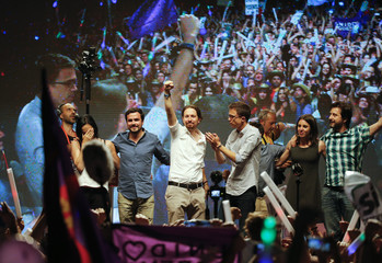 Podemos (We Can) party leader Pablo Iglesias and Izquierda Unida (United Left) leader Alberto Garzon address supporters after Spain's general election in Madrid