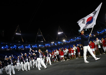 South Korea's flag bearer Yoon Kyung Shin holds the national flag during the opening ceremony of the London 2012 Olympic Games