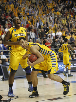Marquette University's Lockett celebrates with Gardner after defeating Butler University in NCAA basketball game in Lexington