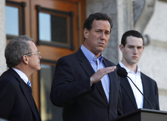 Republican presidential candidate Rick Santorum (C) speaks to a crowd at a news conference at the Ohio Statehouse in Columbus