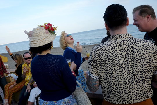 German pin-up Steiner, dressed in fifties-style outfit, smiles as she and her friends attend the 22th Rockin' Race Jamboree International Festival in Torremolinos