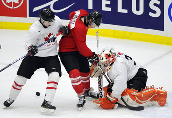 Canada's Team White goalie Tyler Bunz makes a save on Team Red Tyler Toffoli in front of Jaden Schwartz during their inter-squad game in Calgary