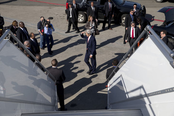 U.S. Secretary of State Kerry walks to say goodbye before boarding his plane to return to the United States, at Mohammed V International Airport in Casablanca