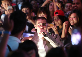Nick Jonas performs amid members of the audience during the iHeartRadio Much Music Video Awards (MMVAs) in Toronto