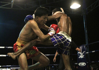 A blind boxer Sujet Salee fights his blindfolded opponent Peeraphong Ngaongam in Surin province