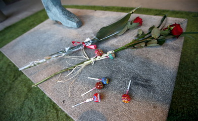Flowers and lollipops are seen on a soccer sculpture at Camp Nou stadium in honour to Johan Cruyff, who died in Barcelona on Thursday following a five-month battle with lung cancer in Barcelona