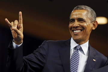 """U.S. President Obama flashes the """"Hook 'Em Horns"""" symbol from the University of Texas as he addresses the Young African Leaders Initiative (YALI) Mandela Washington Fellowship Presidential Summit in Washington"""