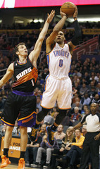Oklahoma City Thunder's Westbrook shoots over the defense of Phoenix Suns' Dragic during their NBA basketball game in Phoenix