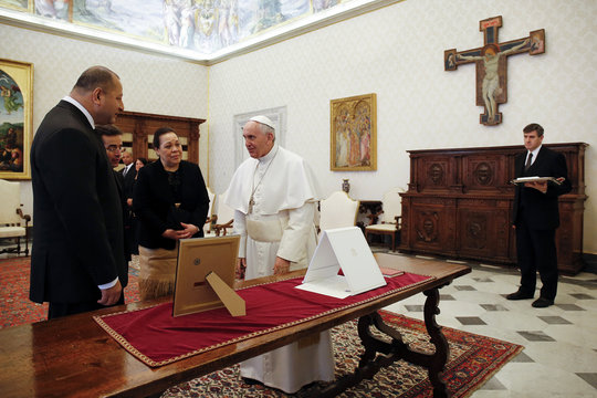Pope Francis exchanges gifts with Tonga's King Tupou VI and Queen Nanasipau'u during a private audience at the Vatican